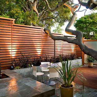 Example of a trendy courtyard stone patio design in San Francisco with no cover