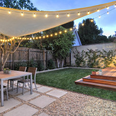 Contemporary Patio by Flores Landscaping