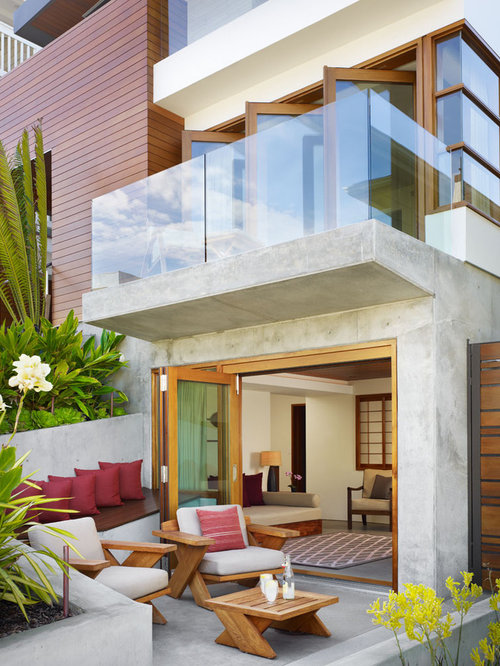 inspiration for a mid sized tropical front yard concrete patio remodel in los angeles - Front Patios Design Ideas