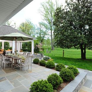 Mid-sized elegant backyard stone patio photo in DC Metro