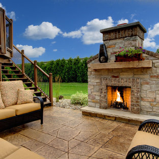 Patio - traditional concrete paver patio idea in Other with a fire pit