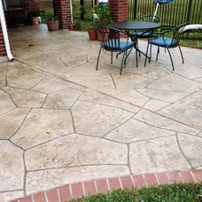 Traditional Patio by Bushmaster Landscape Inc