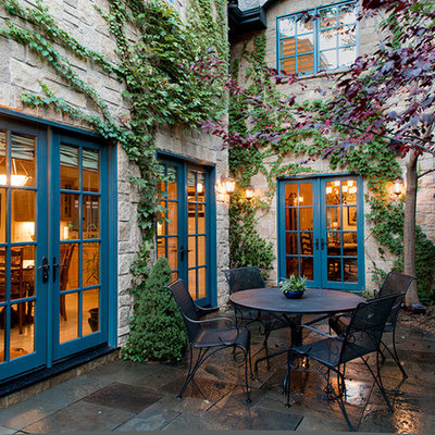 Example of a mid-sized classic side yard stone patio vertical garden design in Denver with no cover
