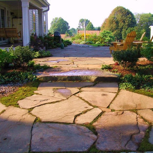 Mid-sized traditional backyard patio in New York with natural stone pavers.