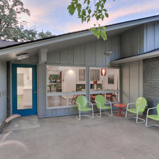 Midcentury Exterior by PBH Construction