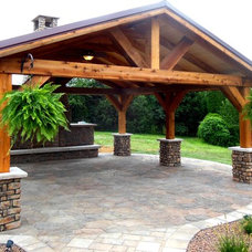Rustic Patio by Weddington Fence And Deck