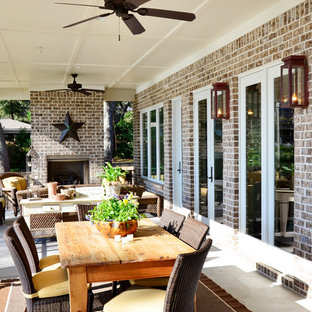 Inspiration for a timeless patio remodel in Miami with a fire pit
