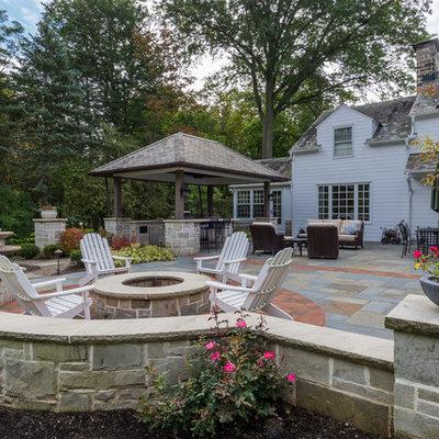 Patio kitchen - mid-sized traditional backyard stone patio kitchen idea in Cleveland with a gazebo