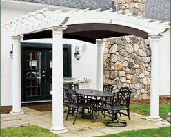 "Pergola, Arched, Round Column - Sizes are measured on-center of the posts and have a 1 1/2"" overhang. Tapered Tuscan fiberglass columns with capital and decorative base. Crafted in low maintenance cellular PVC. Factory primed and painted. Shades offered with manual rope drive in Black, Heather Beige, Forest Green, Burgundy and Taupe. ShadeFX Canopy sold separately. Crated and shipped motor freight. Arrives ready to install."