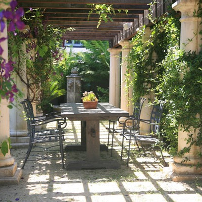 Example of a tuscan patio design in San Francisco with a pergola
