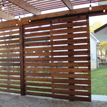 Pergola privacy screen with sliding door