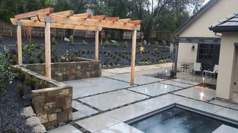 Pergola with bocce ball court in background