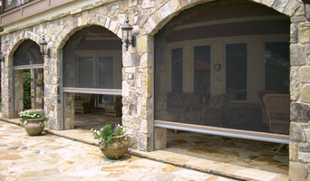 Phantom retractable screens in stone archway
