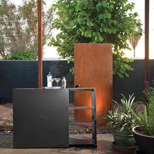 Patio - contemporary concrete patio idea in Phoenix