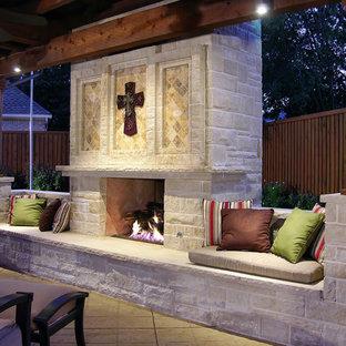 Patio kitchen - large traditional backyard concrete paver patio kitchen idea in Dallas with a pergola
