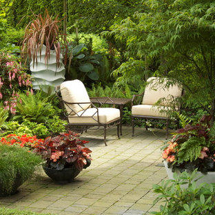 Example of a classic concrete paver patio design in Vancouver with no cover