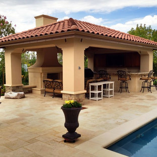 Medium sized mediterranean back patio in San Francisco with an outdoor kitchen, natural stone paving and a gazebo.