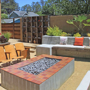 Inspiration for a large mediterranean backyard patio in San Francisco with decomposed granite, no cover and a fire feature.