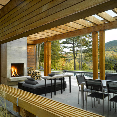 Trendy patio photo in Burlington with a fire pit and a pergola