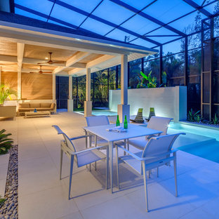 This is an example of a contemporary patio in Tampa with a water feature.
