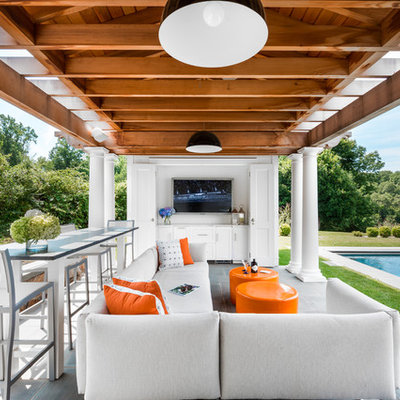 Inspiration for a mid-sized transitional backyard concrete paver patio remodel in New York with a gazebo