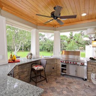 Tuscan patio kitchen photo in Orlando with a gazebo
