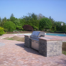 Traditional Patio by Longo's Landscaping & Masonry