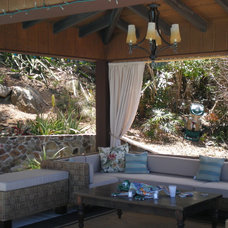Tropical Patio by Lagnappe Custom Interiors