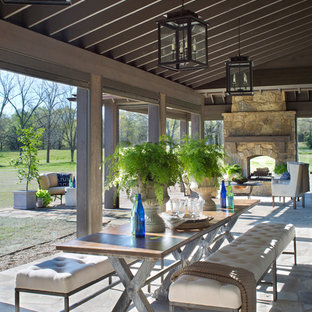 Patio   Farmhouse Backyard Stone Patio Idea In Nashville With A Fire Pit  And A Roof