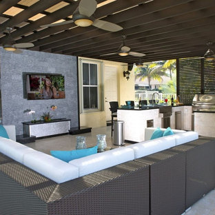Inspiration for a mid-sized modern backyard stamped concrete patio kitchen remodel in Tampa with a pergola