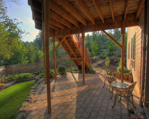 inspiration for a timeless patio remodel in portland with concrete pavers and a roof extension - Patio Ideas Under Deck