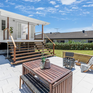 This is an example of a contemporary patio in Brisbane with no cover.
