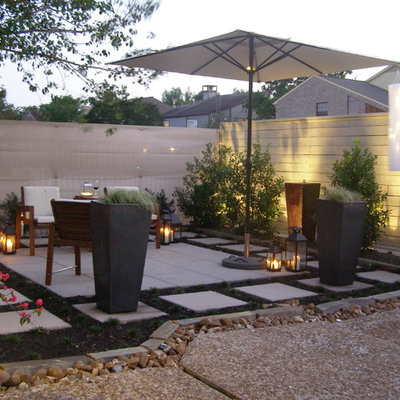 Inspiration for a contemporary patio remodel in Houston with no cover