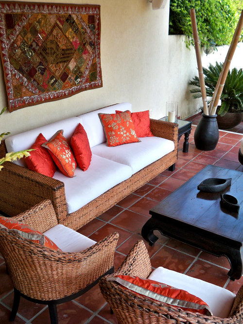 Example Of A Zen Tile Patio Design In Other