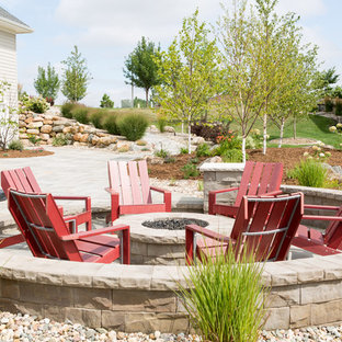 Example of a mid-sized trendy backyard concrete paver patio design in Other with a fire pit and no cover