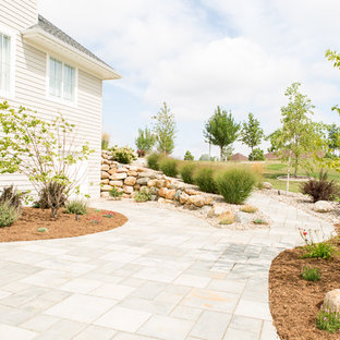 Mid-sized trendy backyard concrete paver patio photo in Other with no cover