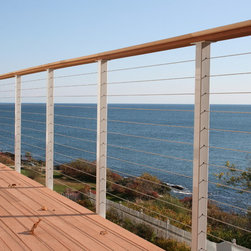 DIY Railing System - DIY cable railing kit installed by the client on this beautiful east coast home. Stainless steel railing posts with powder coat, stainless steel cable infill, and natural wood top railings. The ultimate in corrosion resistant post systems.