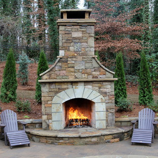 Example of a large classic backyard concrete paver patio design in Atlanta with a fire pit and no cover