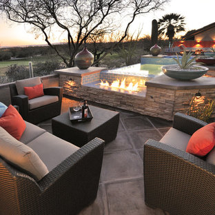 Patio - southwestern patio idea in Phoenix with a fire pit