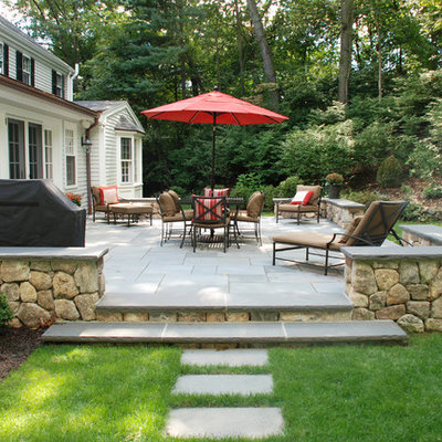 Example of a large classic backyard concrete paver patio design in Miami with no cover