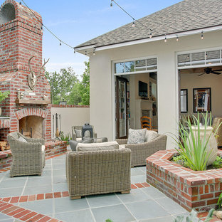 Mid-sized transitional courtyard brick patio photo in New Orleans with no cover
