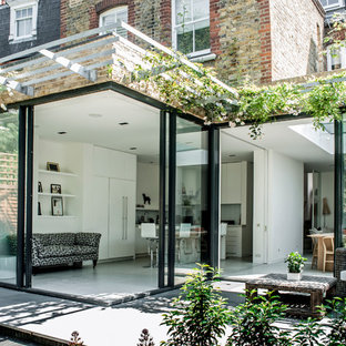 This is an example of a contemporary patio in London with a pergola.