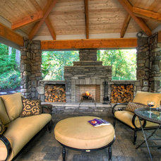 rustic patio by Paradise Restored Landscaping & Exterior Design