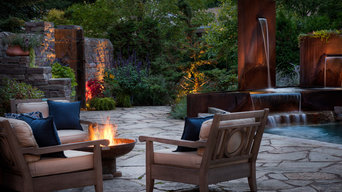 Private Patio with Stone Wall and Corten Fountain