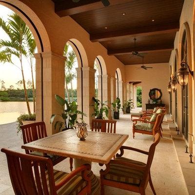 Patio - mediterranean patio idea in Miami