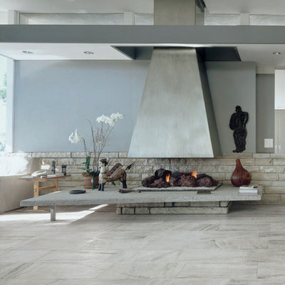 Large trendy tile patio photo in Orange County with a roof extension and a fireplace