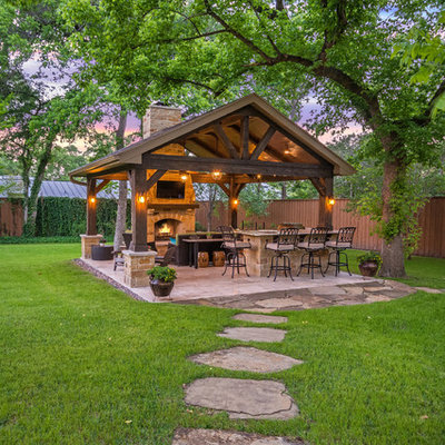 Inspiration for a mid-sized rustic backyard tile patio kitchen remodel in Houston with a gazebo