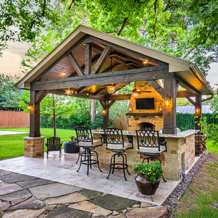 Photo of a mid-sized country backyard patio in Houston with an outdoor kitchen, tile and a gazebo/cabana.