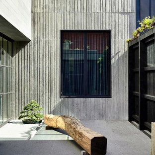 Modern courtyard patio in Los Angeles with tile and no cover.