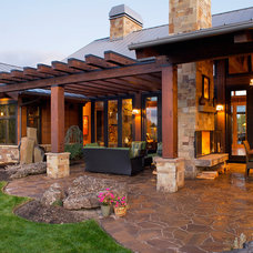 Rustic Patio by Baylis Architects